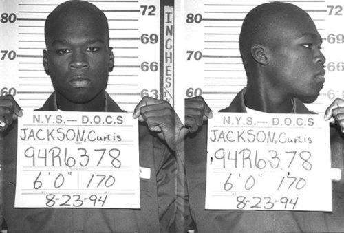 NEW YORK - AUGUST 23: 50 Cent (Curtis Jackson) has his mug shot taken while serving time in a New York State Department of Correctional Services shock incarceration program on August 23 1994 in New York NY.  (Photo by Michael Ochs Archive/Getty Images)